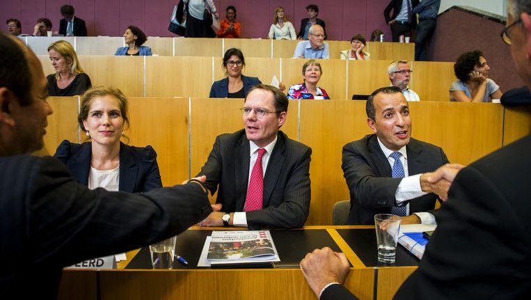 Udo Kock (midden) tijdens de installatie in de Amsterdamse gemeenteraad. Volgens de wethouder gaan de decentralisaties veel duurder uitpakken. Beeld anp