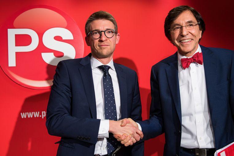 Pierre-Yves Dermagne en Elio Di Rupo op een persconferentie van de PS in Brussel, 27 januari 2017.  Beeld BELGA