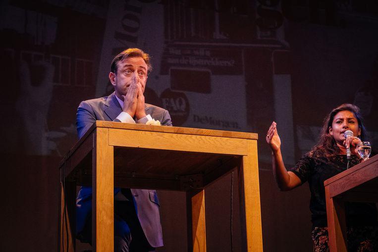 N-VA-burgemeester Bart De Wever (links) en sp.a-kopvrouw Jinnih Beels tijdens een verkiezingsdebat in september. Beeld Wouter Van Vooren