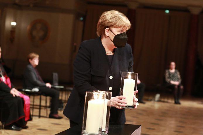 Angela Merkel tijdens de herdenkingsdienst.