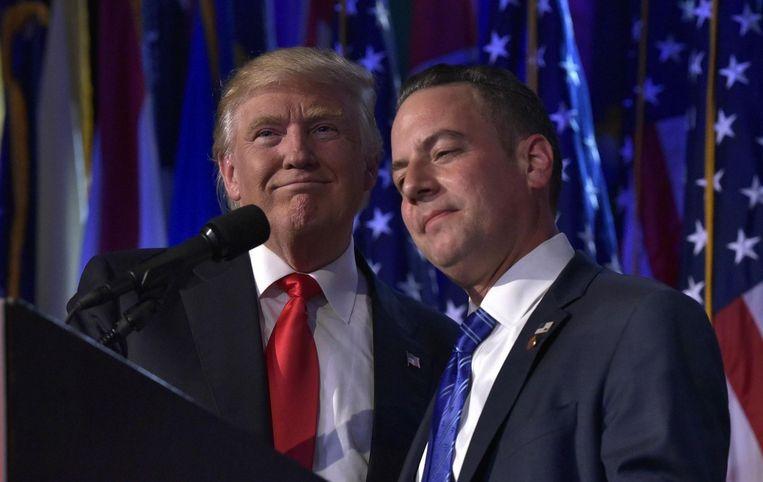 Reince Priebus (rechts) is in de race voor het ambt van kabinetschef. Beeld afp