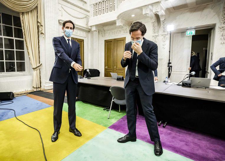 Wopke Hoekstra (CDA) en Mark Rutte (VVD) na het debat van NPO Radio 1. Beeld EPA