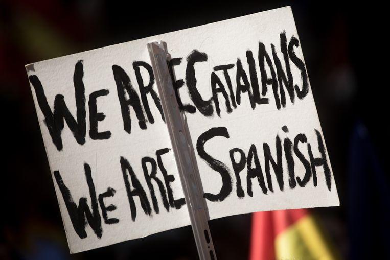 Archiefbeeld: een pancarte van een betoger tegen de Catalaanse onafhankelijkheid. Beeld Getty Images