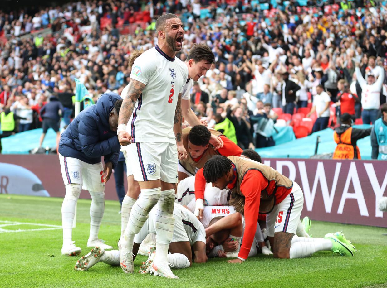 Kyle Walker schreeuwt het uit na de goal van Harry Kane. Beeld Pool via REUTERS