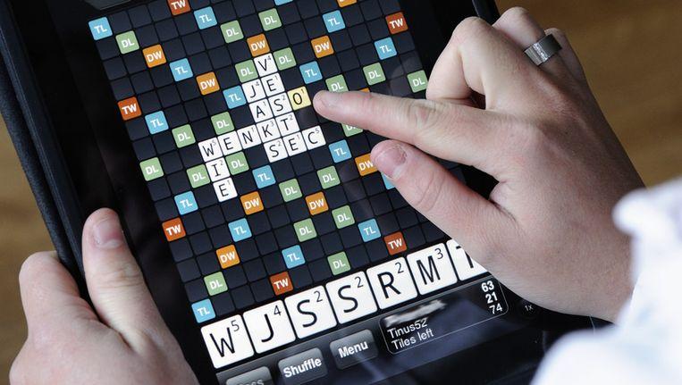 Het spel Wordfeud wordt hier gespeeld op een iPad. © ANP Beeld
