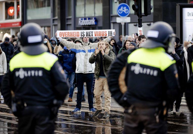 Demonstranten op het Museumplein, afgelopen januari. Kritiek op de uitholling van de democratie komt vooral van 'wappies', zegt John Jansen van Galen. Beeld ANP