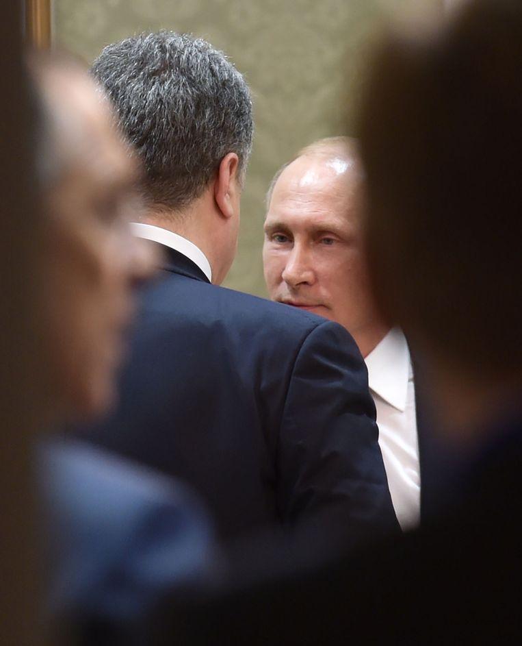 Poetin in overleg met Porosjenko. Beeld AFP