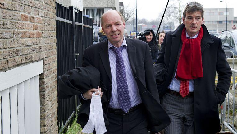 De advocaten van Robert M. arriveren bij de rechtbank in Amsterdam. Links mr. Wim Anker en rechts mr. Tjalling van der Goot. Foto Beeld anp