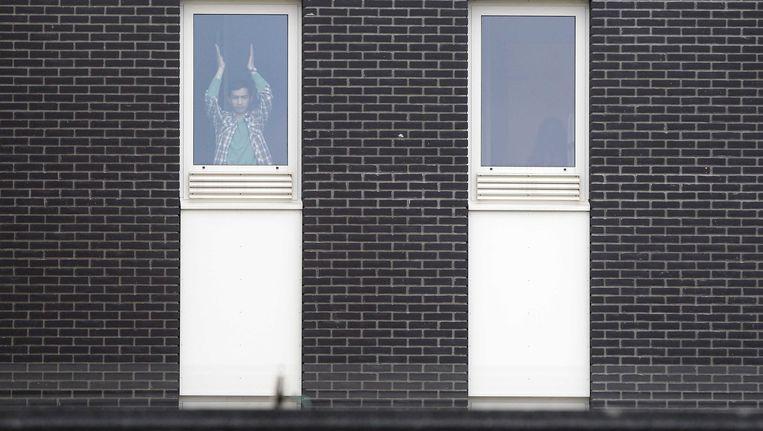 Een hongerstakende asielzoeker in het detentiecentrum van Rotterdam. Beeld anp