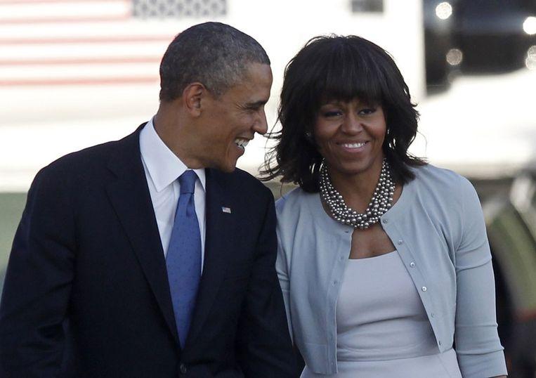 De Amerikaanse president Barack Obama en zijn vrouw Michelle. Beeld reuters