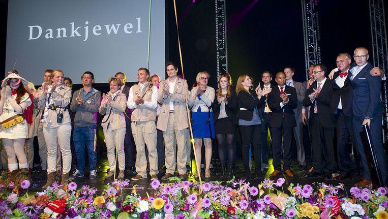 Het personeel van de Floriade 2012 tijdens de slotceremonie Beeld ANP