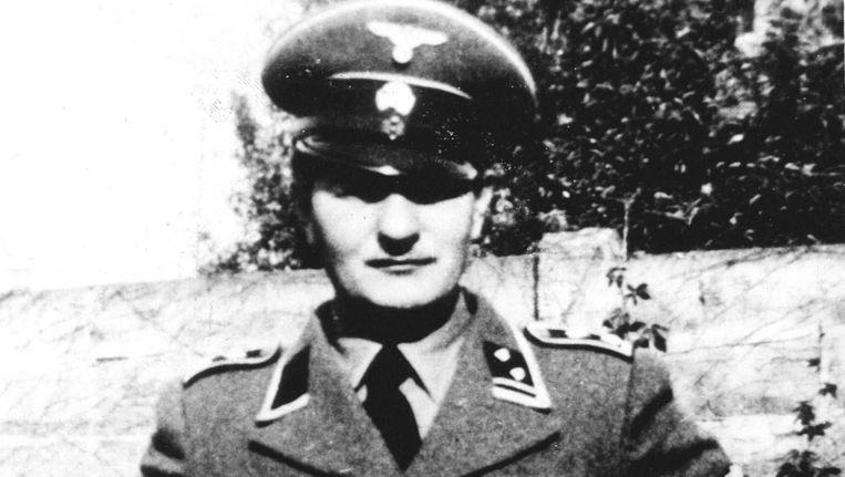Pieter Menten in een Duits uniform in de Tweede Wereldoorlog. Volgens zijn advocaat was de foto niet echt Beeld ANP