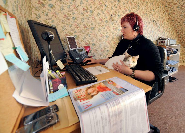 Ondernemingen en werknemers lijden onder het thuiswerk, luidt het. 'Mensen verliezen voeling met de werkvloer.' Beeld IMAGEGLOBE