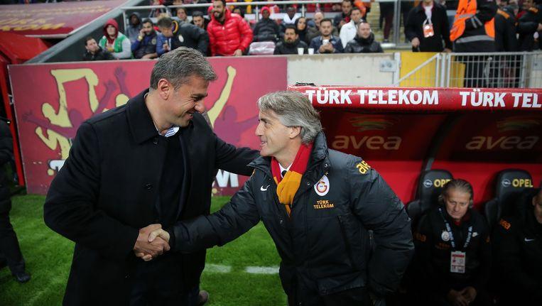 Hamza Hamzaoglu (links) met Roberto Mancini. Beeld PHOTO_NEWS