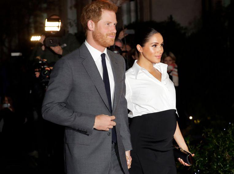 Prins Harry en een zwangere Meghan Markle, begin februari. Beeld AP