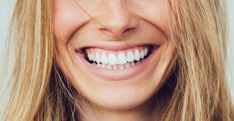 De oorzaken en oplossingen voor ontstoken tandvlees. Beeld Getty Images