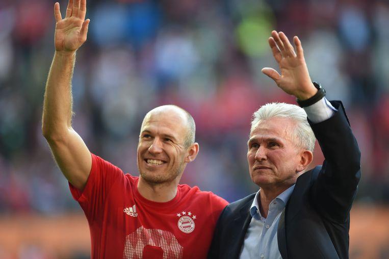 Arjen Robben met coach Jupp Heynckes. Beeld AFP