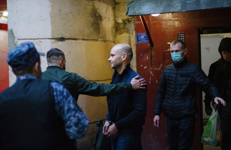 Andrej Pivovarov werd uit een vliegtuig gehaald dat op het punt stond om naar Warschau te vertrekken, en werd gearresteerd.  Beeld AP