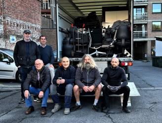 Serviceclub Lions en De Vrolijke Kring brengen een vrachtwagen vol kantoormeubelen van Rondom naar getroffen Waals dorp