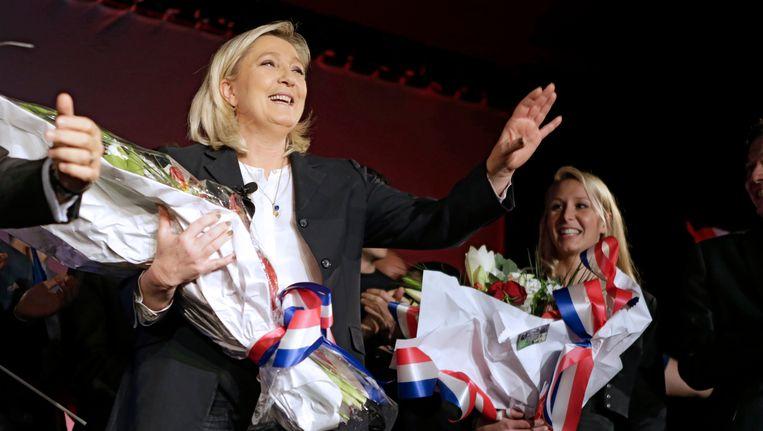 Marine Le Pen en Marion Marechal-Le Pen tijdens een FN-bijeenkomst in Nice. Beeld AP