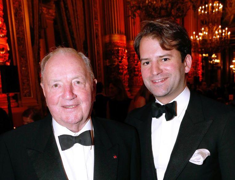 Albert Frère en zijn kleinzoon Cédric. De troonsbestijging van de jonge Frère is een sluitstuk van een verhaal dat reeds in 2010 begon. Beeld Getty Images