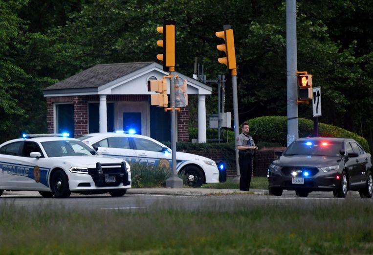 Politiewagens aan het hoofdkwartier van de CIA in Langley, Virginia, in de VS. Beeld AFP