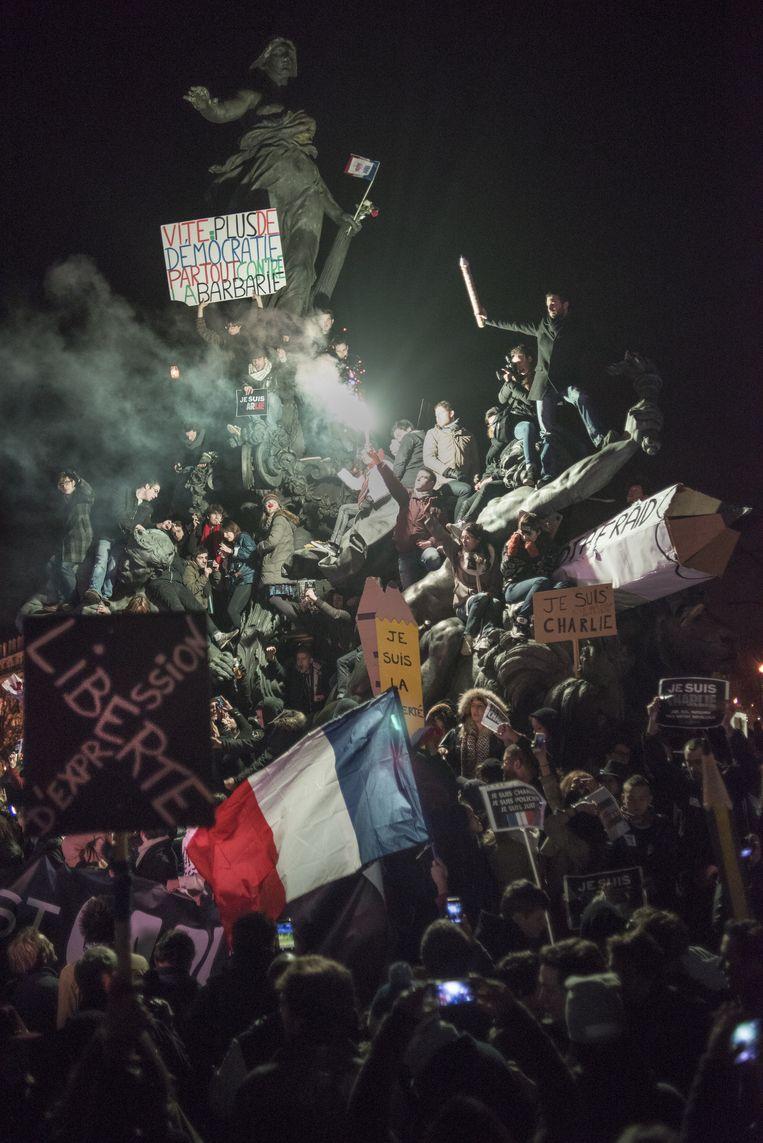Mars van de Republiek, zondag 11 januari in Parijs, tegen de aanslagen op de redactie van Charlie Hebdo en op de joodse supermarkt. Beeld Martin Argyroglo
