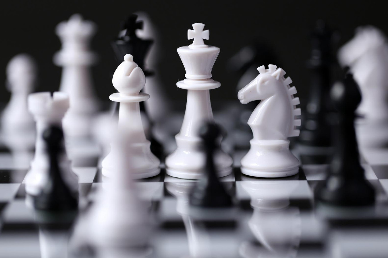 Chess piece on a chess board, black and white