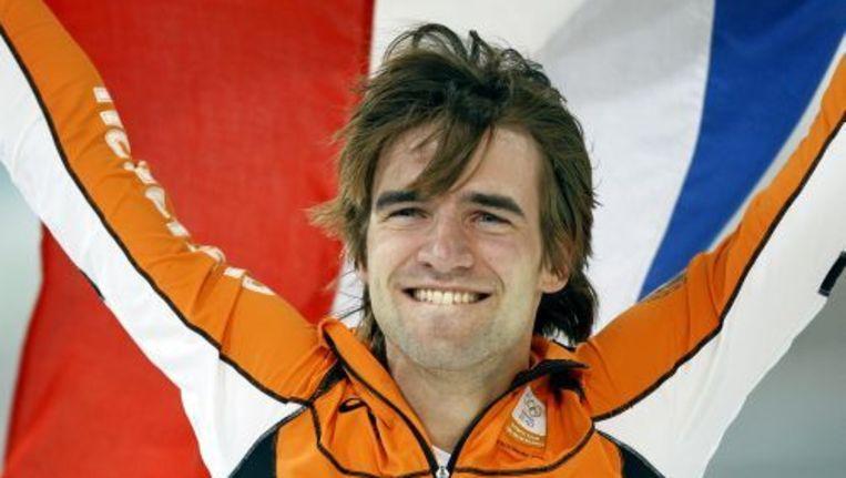 Schaatser Mark Tuitert viert zijn overwinning op de 1500 meter voor mannen tijdens de Olympische Spelen in Vancouver. ANP Beeld