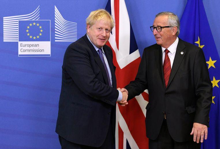 Johnson naast Juncker.