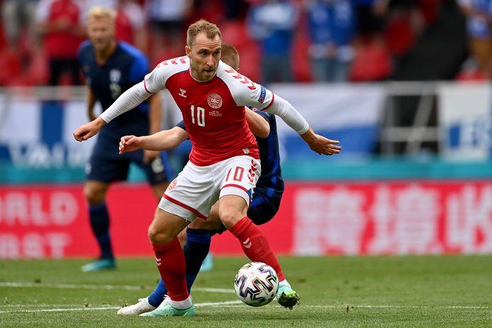 Denmark's Christian Eriksen controls the ball during the Euro 2020 soccer championship group B match between Denmark and Finland at Parken Stadium in Copenhagen, Saturday, June 12, 2021. (Stuart Franklin/Pool via AP)