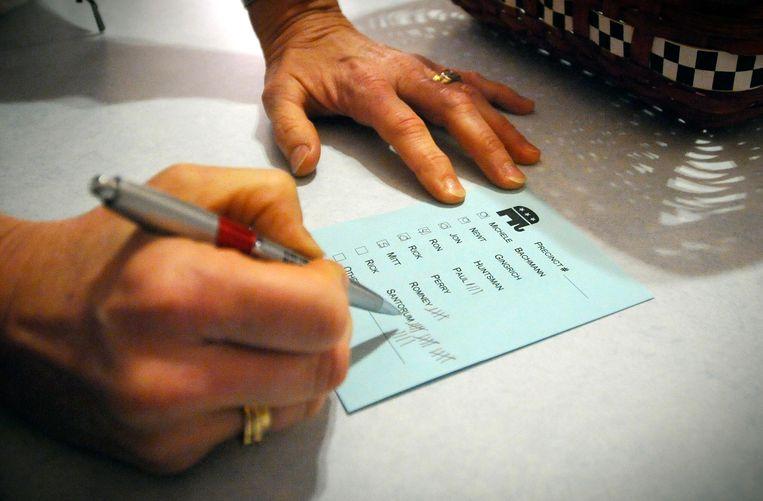 Een stembiljet van de Republikeinse caucus in Iowa in 2012. Beeld AP