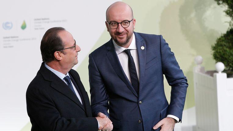 De Franse president Hollande met Belgisch premier Charles Michel. Beeld AP