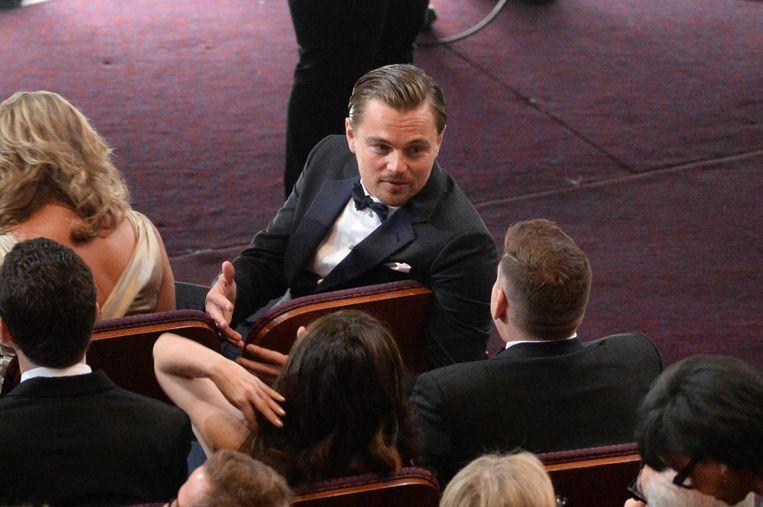 Leonardo DiCaprio op 2 maart 2014 in het Dolby Theater in Hollywood, bij een van de gelegenheden dat hij naast een beeldje greep ¿ voor zijn hoofdrol in The Wolf of Wall Street, dit keer. Beeld getty