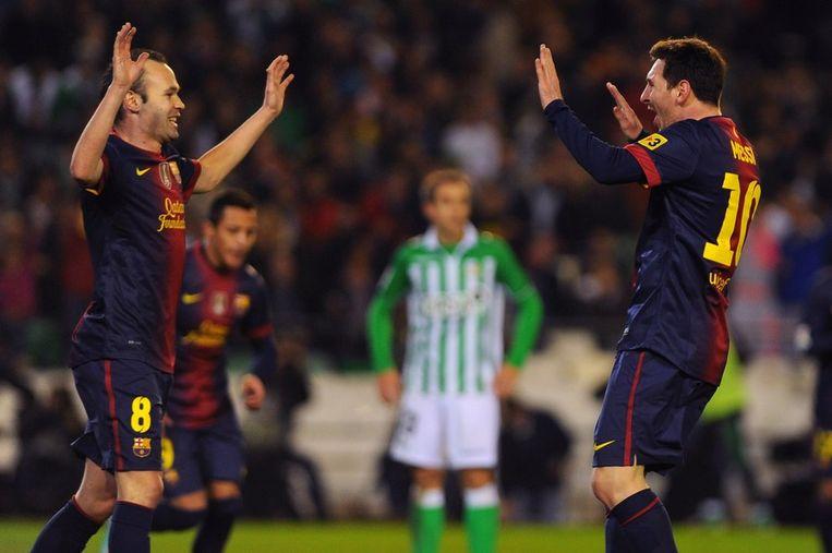 Andres Iniesta (links) en Lionel Messi. Beeld afp