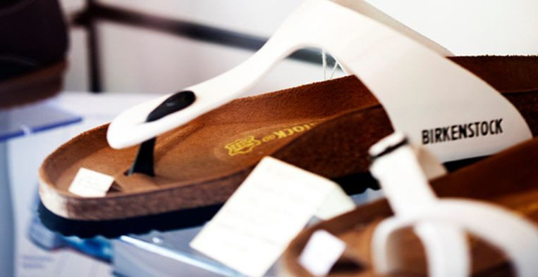 Bellagio, Italy - September 30, 2011: Birkenstock sandals displayed on shelves in a shoe shop in Bellagio, Northern Italy. Beeld Getty Images