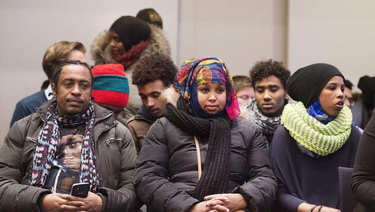 Bewoners van de Vluchtgarage tijdens de zitting van de rechtbank. Beeld anp