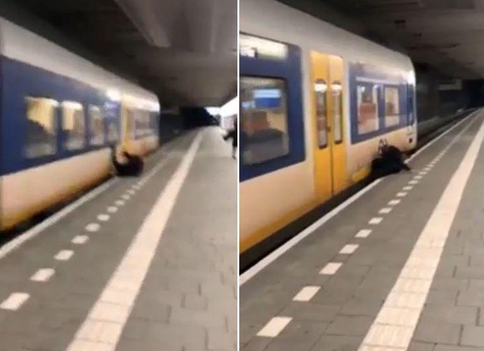 De jongen ontsnapt ternauwernood aan de trein.