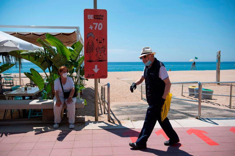 Het strand van Lloret de Mart.  Beeld AFP