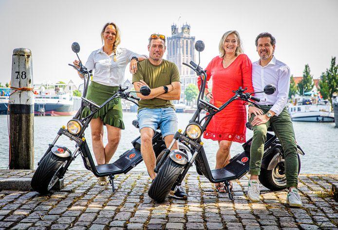 De vier vrienden met twee van hun tien E-choppers. V.l.n.r. Claire Lochmans, Guido van Zurk, Nathalie Barendswaard en Robert Pennings.