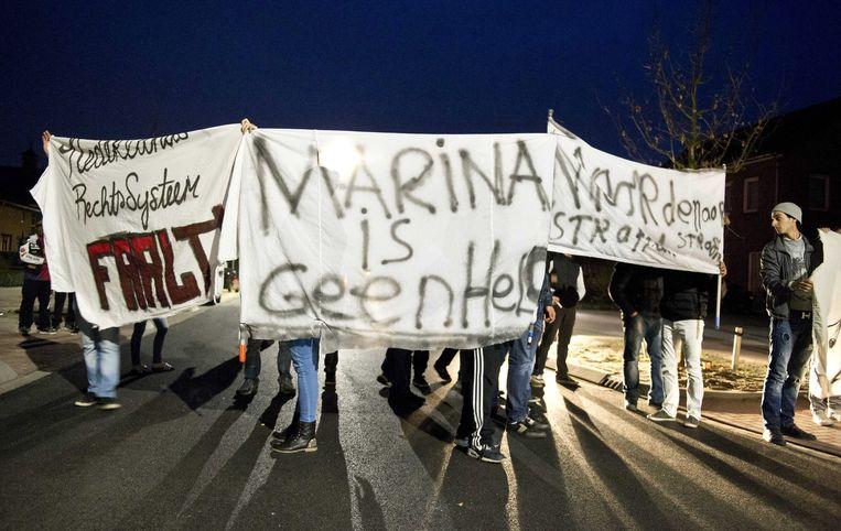 Demonstratie tegen het juweliersechtpaar in Deurne. Beeld EPA