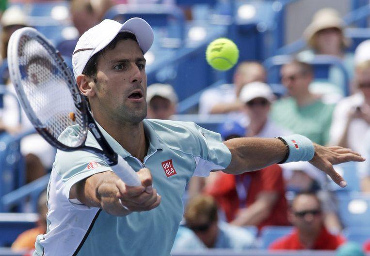 Novak Djokovic kon het niet bolwerken tegen John Isner. Beeld ap