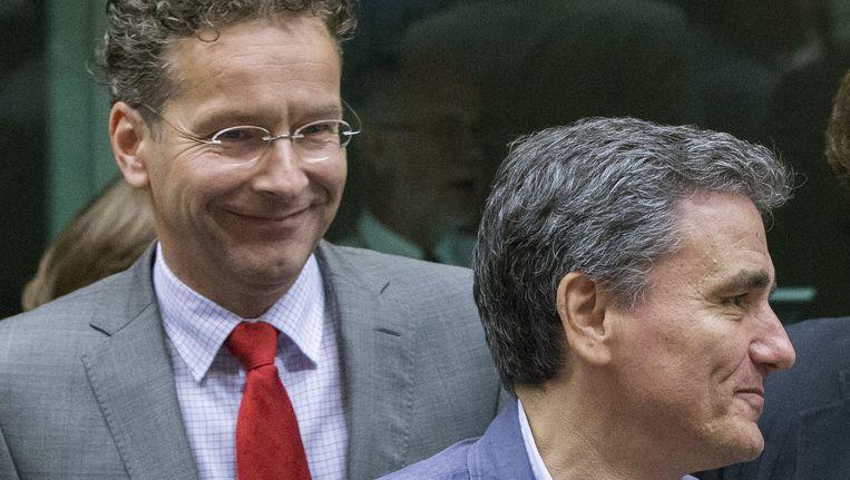 Jeroen Dijsselbloem en de Griekse minister van Financiën Tsakalotos. Beeld REUTERS