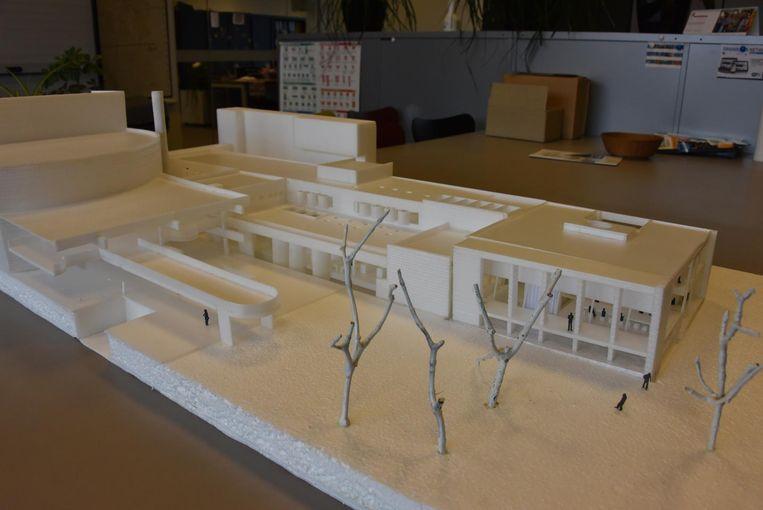Een maquette van de nieuwe bib, die tussen de Warande en Het Kasteeltje komt te liggen.