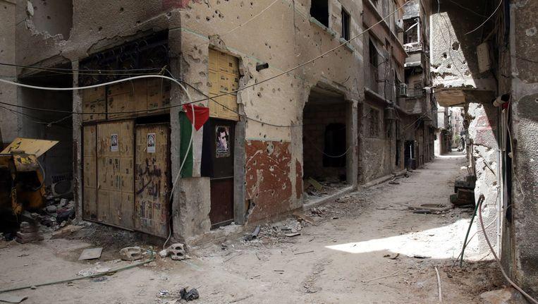 Het door IS deels bezette Palestijnse vluchtelingenkamp Jarmoek in het zuiden van Damascus. Beeld EPA