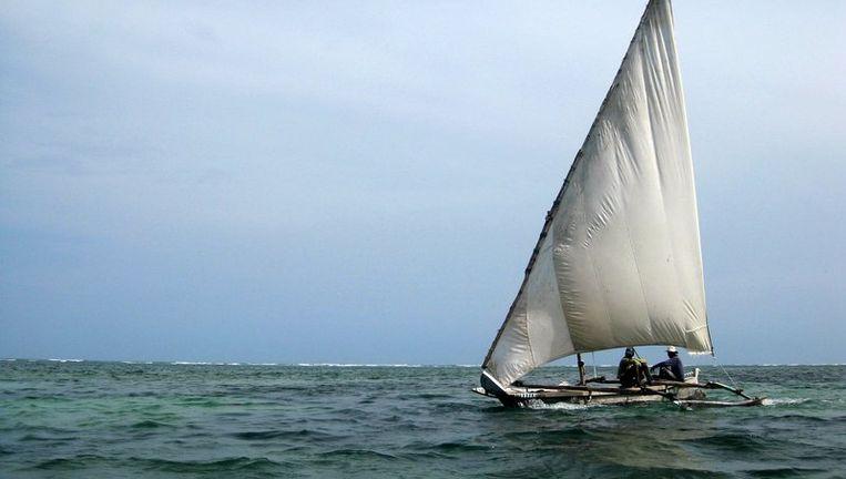 Vissers met hun bootje op de Indische Oceaan. Beeld reuters