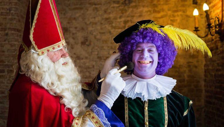 Sinterklaas en kleurenpiet. Beeld anp