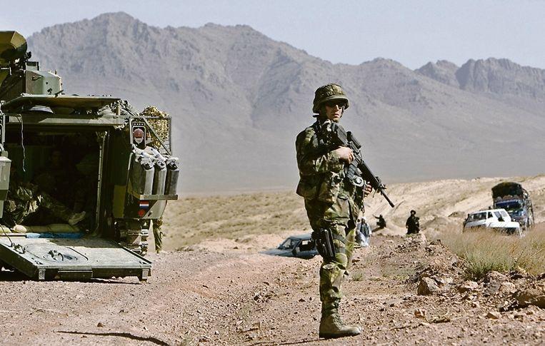 Nederlandse troepen op weg naar Tarin Kowt, in Uruzgan. Archiefbeeld.  Beeld Gerben van Es