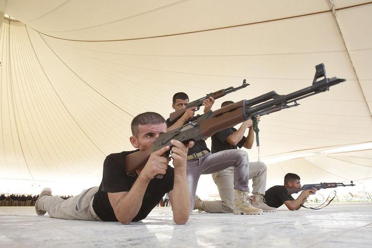 Shiitische vrijwilligers tijdens een militaire training in Irak. Beeld anp