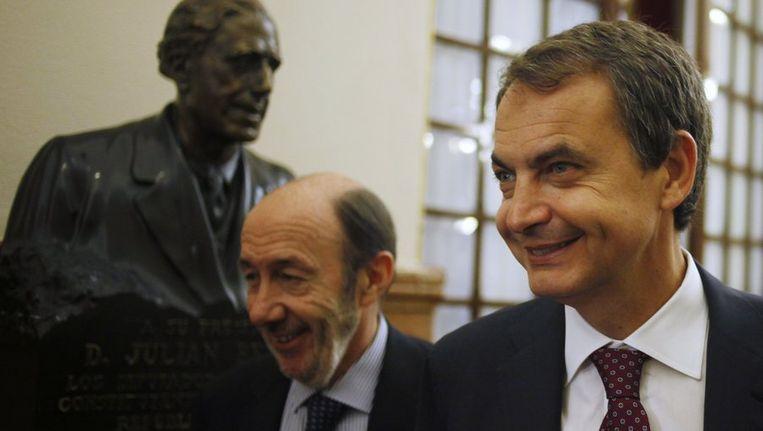 Premier Zapatero (R) en Rubalcaba. Beeld reuters